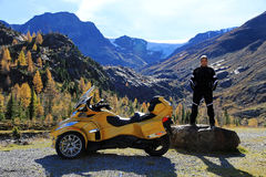 A man in motorcycle clothing with its Can Am Spyder Royalty Free Stock Photography