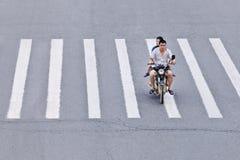 Man on motorcycle crossing zebra path, Yantai, China Stock Photos