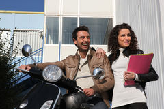 Man on a motorcycle  girlfriend Stock Photos