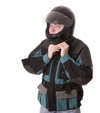 Man in motorcycle jacket buttoning helmet. Stock Images