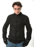 Man in motorcycle jacket Stock Image