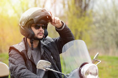 Man on the motorcycle posing. View of a man on the motorcycle with a helmet on Stock Image