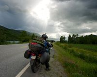Man on motorcycle on the road. Motorcycle traveler with a luggage stock photo
