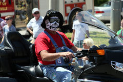 Man on motorcycle wearing skull mask Stock Photos