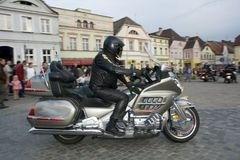 Man on Motorcyle in Plaza Stock Image