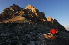 Man and mountain. The Grand Teton from the lower saddle in the sunset Stock Photography