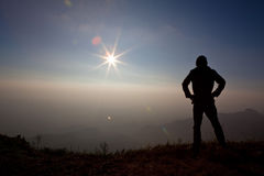 Man on the Mountain. Silhouette of a man on the Mountain Royalty Free Stock Images