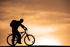 Man at mountain bicycle Stock Photography