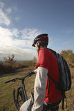 Man On Mountain Bike Looking At View In Countryside Stock Photos