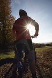 Man On Mountain Bike Looking At View Stock Image