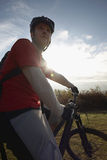 Man On Mountain Bike Looking At View Stock Photography