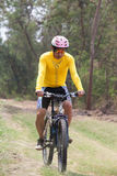 Man and mountain bike riding in jungle track use for bicycle spo Stock Images