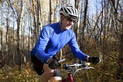 Man mountain biking Stock Image