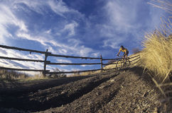 Man Mountain Biking Along Country Path Royalty Free Stock Photos