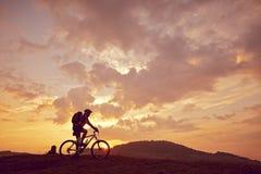 Man mountain biking sunny side view Stock Photo