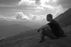 Men on a mountain. Man on a mountain black and white Stock Image