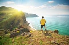 Man on mountain cliff royalty free stock photos