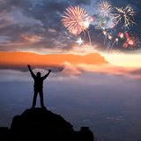 A man at mountain and fireworks Stock Photo