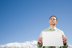 Man by mountain with paper Royalty Free Stock Photos