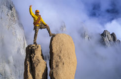 Man on a mountain peak. Stock Photos