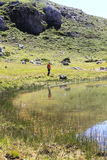 Man and a mountain reflected on a lake Stock Photography