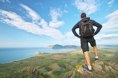 Man and mountain sea landscape panorama stock photography