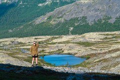 Man in mountain standing on peak Royalty Free Stock Photography