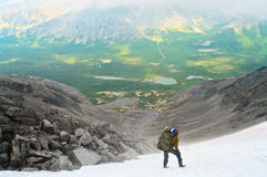 Man in mountain standing on peak Stock Image