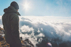 Man on mountain summit with sun over clouds. Travel hiking Lifestyle success concept adventure active vacations outdoor Royalty Free Stock Images