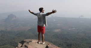 Man On Mountain Top Raise Hands Looking At Beautiful Landspace Back Rear View Of Male Tourist