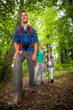 Man on a mountain trail with friends Stock Photo