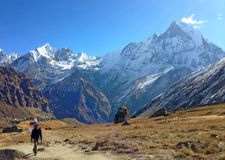 Man and mountain view Machapuchare. Way to Annapurna Bace Camp Stock Photo