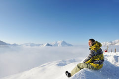 Man at mountains in clouds Stock Image