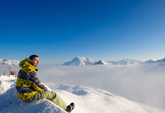 Man at mountains in clouds Stock Photos