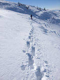 The man in the mountains is on a difficult path. Royalty Free Stock Image