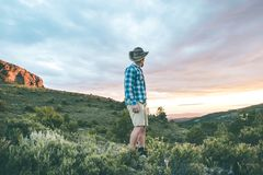 Man in the mountains, dressed in vintage style stock photo