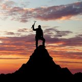 Man on mountains with ice axe in hand Royalty Free Stock Photography