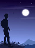 The man in mountains at night Royalty Free Stock Photo