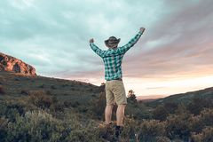 A man in the mountains with a positive gesture royalty free stock photography
