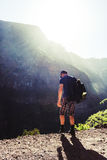 Man in the mountains. Traveler in the mountains at sunshine stock photos