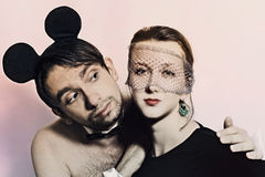 Man with mouse ears and woman in a veil Royalty Free Stock Photography