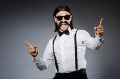 Man with moustache and sunglasses against gray Stock Photography