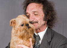 Man with moustaches and the doggie with a beard Stock Photos