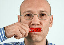 Man with mouth tightly closed Royalty Free Stock Image