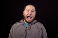 Man with mouth wide open isolated Stock Images