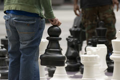 Man Moves Piece People Playing Giant Chess Game Sidewalk Downtow Royalty Free Stock Images