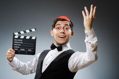 Man with movie board Stock Images