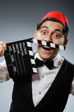 Man with movie board Stock Photos