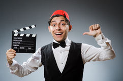 Man with movie board wearing Royalty Free Stock Photo