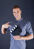 Man with movie clap Stock Photography